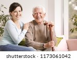 happy senior man with walking... | Shutterstock . vector #1173061042