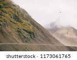 mountains in a fog in iceland | Shutterstock . vector #1173061765