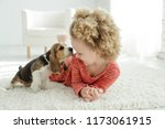 child with dog  | Shutterstock . vector #1173061915