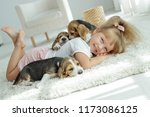 child with dogs | Shutterstock . vector #1173086125