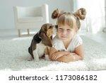 Stock photo child with dog 1173086182