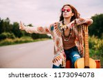 hitchhiking girl. beautiful... | Shutterstock . vector #1173094078