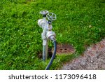 faucet in a park to adjust... | Shutterstock . vector #1173096418