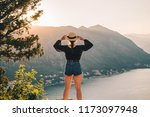 woman standing on the top of... | Shutterstock . vector #1173097948