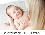 loving baby sleeping in mother... | Shutterstock . vector #1173159862