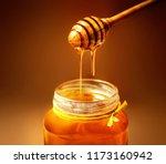 honey in jar with honey dipper... | Shutterstock . vector #1173160942