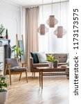 lamps above wooden table with...   Shutterstock . vector #1173173575