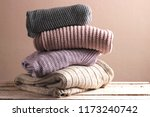 a pile of warm sweaters on a... | Shutterstock . vector #1173240742