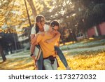 young student couple making fun ... | Shutterstock . vector #1173272032