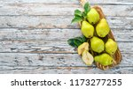 fresh pears on a white wooden...   Shutterstock . vector #1173277255