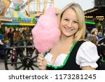 young blond woman in dirndl... | Shutterstock . vector #1173281245
