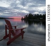 Chair On The Dock At Sunset In...