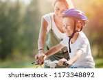 little boy learns how to ride... | Shutterstock . vector #1173348892
