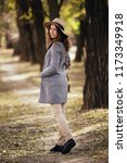 happy smile young woman walking ... | Shutterstock . vector #1173349918