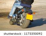 biker in jeans riding a... | Shutterstock . vector #1173350092