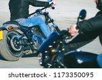 biker in jeans riding a... | Shutterstock . vector #1173350095