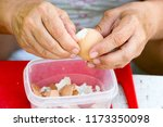 a woman cleans a boiled chicken ... | Shutterstock . vector #1173350098