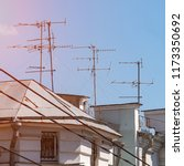 tv antenna on the roof of the... | Shutterstock . vector #1173350692