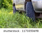 wheels a car suv in the forest... | Shutterstock . vector #1173350698