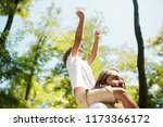funny blond boy with his father ... | Shutterstock . vector #1173366172