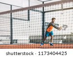 man playing padel in a orange... | Shutterstock . vector #1173404425