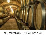 large wooden barrels in wine... | Shutterstock . vector #1173424528