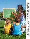 mathematics lesson on open air | Shutterstock . vector #1173438865