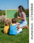 mathematics lesson on open air | Shutterstock . vector #1173438868