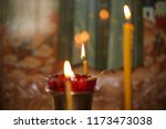 candles thin burn in the church | Shutterstock . vector #1173473038