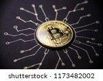 gold coin bitcoin lies on the... | Shutterstock . vector #1173482002