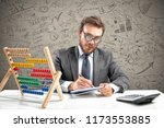 nerd accountant does... | Shutterstock . vector #1173553885