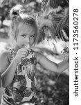 summer funny little girl near... | Shutterstock . vector #1173560278