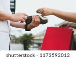 man make payment with credit... | Shutterstock . vector #1173592012