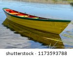 A Single Yellow Wooden Dory...