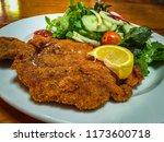 schnitzel or weinerschnitzel... | Shutterstock . vector #1173600718