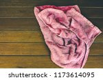 red rag isolate on wooden...   Shutterstock . vector #1173614095