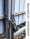 Old Padlock And Chain On The...