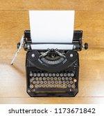 vintage black typewriter on old ... | Shutterstock . vector #1173671842