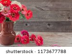 flowers in vase on old wooden... | Shutterstock . vector #1173677788