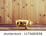 Wooden Plate And Golden Pig