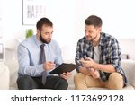 consulting manager with man at... | Shutterstock . vector #1173692128