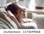 calm pretty millennial woman... | Shutterstock . vector #1173699868