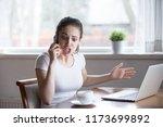 furious woman argue talking on... | Shutterstock . vector #1173699892