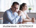 stubborn couple avoid looking... | Shutterstock . vector #1173702415