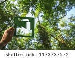 hand holding eco friendly green ... | Shutterstock . vector #1173737572