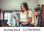 shopping girl with shopping bag....   Shutterstock . vector #1173878965