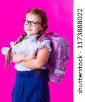 happy  little schoolgirl... | Shutterstock . vector #1173888022