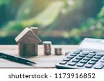 house placed on table. pen... | Shutterstock . vector #1173916852