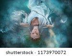 a girl elf in a white dress is... | Shutterstock . vector #1173970072