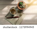 cup of black coffee on book... | Shutterstock . vector #1173994945